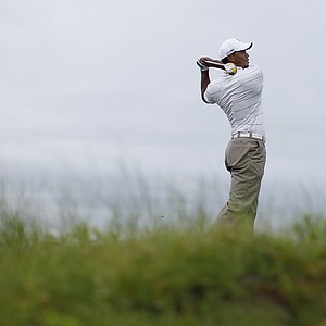 Tiger Woods watches his drive from the 11th tee during a practice round for the PGA Championship golf tournament on the Ocean Course of the Kiawah Island Golf Resort in Kiawah Island, S.C., Wednesday, Aug. 8, 2012.