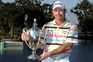 Tommy Gainey holds the trophy after winning the McGladrey Classic PGA Tour golf tournament, Sunday, Oct. 21, 2012, in St. Simons Island, Ga.