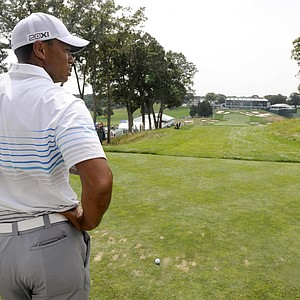 Tiger Woods gets ready to drive in The Barclays Pro-Am golf tournament at Bethpage State Park in Farmingdale, N.Y., Wednesday, Aug. 22, 2012.