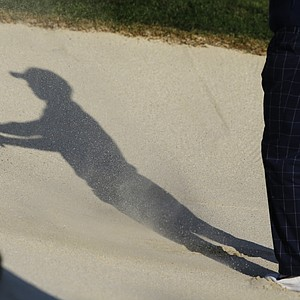 USA's Tiger Woods hits out of a bunker on the 13th hole during a four-ball match at the Ryder Cup PGA golf tournament Friday, Sept. 28, 2012, at the Medinah Country Club in Medinah, Ill.
