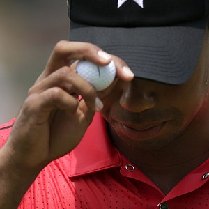 Tiger Woods acknowledges the gallery after putting on the third green during the final round of the AT&T National golf tournament at Congressional Country Club in Bethesda, Md., Sunday, July 1, 2012.