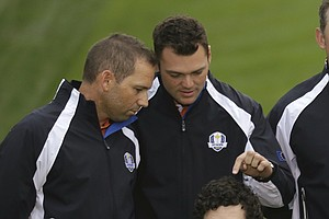 Europe's Sergio Garcia, left, and Paul Lawrie look at Rory McIlroy's hair during their team photo at the Ryder Cup PGA golf tournament Tuesday, Sept. 25, 2012, at the Medinah Country Club in Medinah, Ill.
