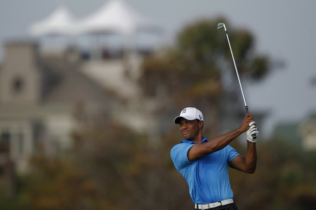 Tiger Woods watch his shot on the 11th hole during the second round of the PGA Championship golf tournament on the Ocean Course of the Kiawah Island Golf Resort in Kiawah Island, S.C., Friday, Aug. 10, 2012