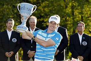 Rory McIlroy, of Northern Ireland, holds the trophy after winning the Deutsche Bank Championship PGA golf tournament at TPC Boston in Norton, Mass., Monday, Sept. 3, 2012.