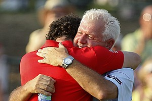 Rory McIlroy of Northern Ireland hugs his father Gerry McIlroy after the final round of the PGA Championship golf tournament on the Ocean Course of the Kiawah Island Golf Resort in Kiawah Island, S.C., Sunday, Aug. 12, 2012.