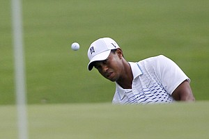 Tiger Woods chips up onto the seventh green during the second round of the BMW Championship PGA golf tournament at Crooked Stick Golf Club in Carmel, Ind., Friday, Sept. 7, 2012.
