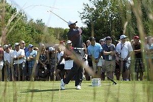 Tiger Woods hits from the third tee during the first round of the Deutsche Bank Championship golf tournament at TPC Boston in Norton, Mass., Friday, Aug. 31, 2012.