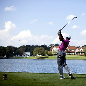 Tiger Woods tees off on the sixth hole during the second round of the Tour Championship golf tournament Friday, Sept. 21, 2012, in Atlanta.