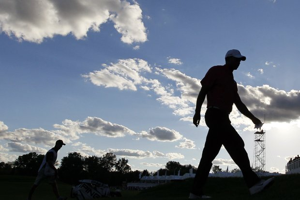 Tiger Woods walks off the 18th green during the third round of the BMW Championship PGA golf tournament at Crooked Stick Golf Club in Carmel, Ind., Saturday, Sept. 8, 2012.