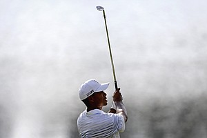 Tiger Woods hits off the fairway on the 17th hole in the first round of the Tour Championship golf tournament, Thursday, Sept. 20, 2012, in Atlanta.