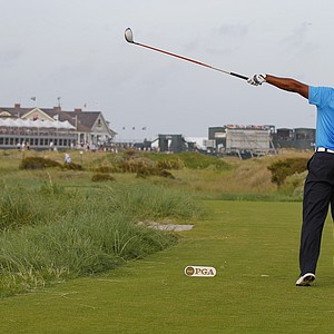 Tiger Woods signals that the ball is going wide after his drive from the 18th tee during the second round of the PGA Championship golf tournament on the Ocean Course of the Kiawah Island Golf Resort in Kiawah Island, S.C., Friday, Aug. 10, 2012.