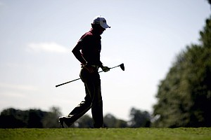 Rory McIlroy, of Northern Ireland, walks off the tee on the fourth hole after hitting during a practice round at the Tour Championship golf tournament Wednesday, Sept. 19, 2012, in Atlanta. The tournament begins Thursday.