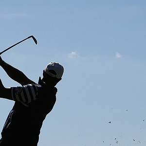 USA's Tiger Woods hits a drive on the third hole during a singles match at the Ryder Cup PGA golf tournament Sunday, Sept. 30, 2012, at the Medinah Country Club in Medinah, Ill.