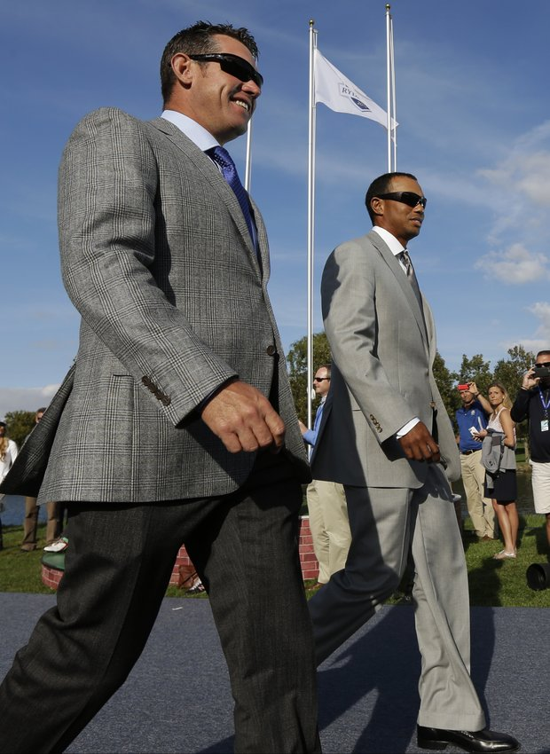 USA's Tiger Woods, right, and Europe's Lee Westwood are introduced during the opening ceremony at the Ryder Cup PGA golf tournament Thursday, Sept. 27, 2012, at the Medinah Country Club in Medinah, Ill.