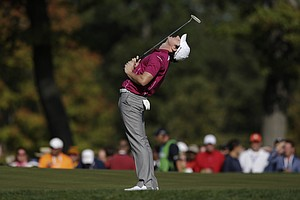Europe's Rory McIlroy reacts after missing a putt on the seventh hole during a foursomes match at the Ryder Cup PGA golf tournament Saturday, Sept. 29, 2012, at the Medinah Country Club in Medinah, Ill.