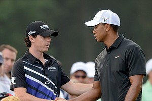 Tiger Woods, right, shakes hands with Rory McIlroy of Northern Ireland before the start of The Barclays golf tournament at Bethpage State Park in Farmingdale, N.Y., Thursday, Aug. 23, 2012.