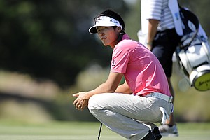 Danny Lee, of South Korea, waits his turn to putt on the 15th green during the third round of the McGladrey Classic PGA Tour golf tournament Saturday, Oct. 20, 2012 in St. Simons Island, Ga.
