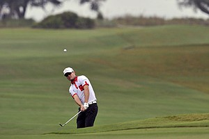 Zach Johnson chips to the 15th green during the first round of The McGladrey Classic PGA Tour golf tournament, Thursday, Oct. 18, 2012, in St. Simons Island, Ga.