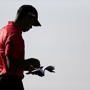 Tiger Woods stands on the 16th green during the final round of the AT&T National golf tournament at Congressional Country Club in Bethesda, Md., Sunday, July 1, 2012.