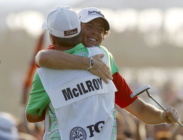 Rory McIlroy of Northern Ireland hugs his caddie after winning the PGA Championship golf tournament on the Ocean Course of the Kiawah Island Golf Resort in Kiawah Island, S.C., Sunday, Aug. 12, 2012.