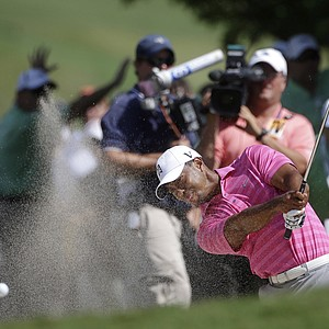 Tiger Woods hits out of the sand on the third fairway during the second round of the Tour Championship golf tournament in Atlanta on Friday, Sept. 21, 2012.