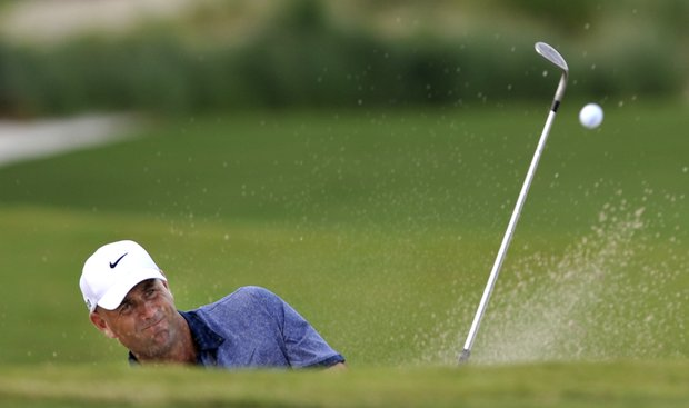 Stewart Cink hits out of the bunker on the 18th green during the first round of The McGladrey Classic PGA Tour golf tournament on Thursday, Oct. 18, 2012, in St. Simons Island, Ga.