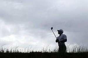 Tiger Woods watches his drive from the 12th tee during a practice round for the PGA Championship golf tournament on the Ocean Course of the Kiawah Island Golf Resort in Kiawah Island, S.C., Wednesday, Aug. 8, 2012.