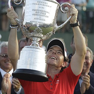 Rory McIlroy of Northern Ireland holds up the championship trophy after the final round of the PGA Championship golf tournament on the Ocean Course of the Kiawah Island Golf Resort in Kiawah Island, S.C., Sunday, Aug. 12, 2012.