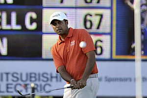 Arjun Atwal, of India, chips onto the ninth green during the second round of the McGladrey Classic PGA Tour golf tournament on Friday, Oct. 19, 2012, in St. Simons Island, Ga.