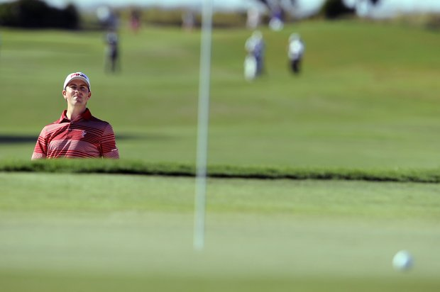 Michael Thompson looks at his ball position after he hit out of the bunker on the 15th green during the third round of the McGladrey Classic PGA Tour golf tournament Saturday, Oct. 20, 2012 in St. Simons Island, Ga.
