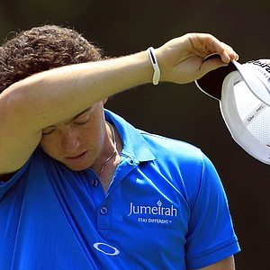 Rory McIlroy, from Northern Ireland, wipes his forehead before teeing off on the third hole during the first round of the Bridgestone Invitational golf tournament at Firestone Country Club, Thursday, Aug. 2, 2012, in Akron, Ohio.