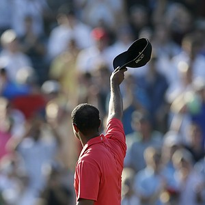 Tiger Woods acknowledges the gallery on the 18th green after winning the AT&T National golf tournament at Congressional Country Club in Bethesda, Md., Sunday, July 1, 2012.