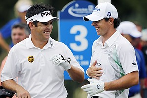 Louis Oosthuizen, left, of South Africa, and Rory McIlroy, of Northern Ireland, laugh while waiting to tee off on the third hole during the third round of the Deutsche Bank Championship PGA golf tournament at TPC Boston in Norton, Mass., Sunday, Sept., 2, 2012.