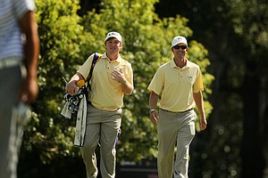Louisiana State assistant coach Garrett Runion, right, with his player Myles Lewis at Isleworth Collegiate Invitational.