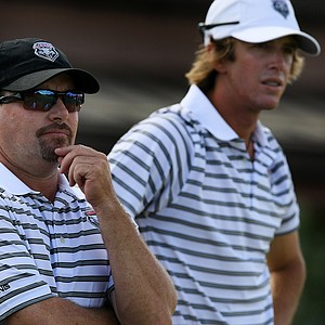 Univesity of New Mexico's head coach Glen Millican, left, with his player James Erkenbeck at No. 10 during the Isleworth Collegiate.
