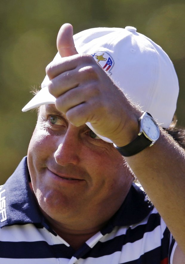 USA's Phil Mickelson reacts after making a birdie on the 11th hole during a singles match at the Ryder Cup PGA golf tournament Sunday, Sept. 30, 2012, at the Medinah Country Club in Medinah, Ill.