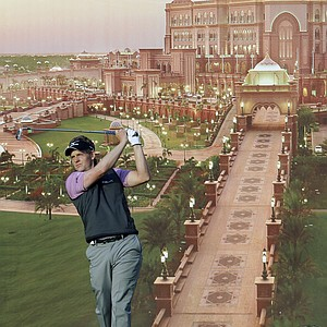 England's Luke Donald tees off on the 12th hole, with a large poster seen in the background, during the first round of Abu Dhabi HSBC Golf Championship, Thursday, Jan. 26, 2012 in Abu Dhabi, United Arab Emirates.