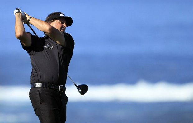 Phil Mickelson hits from the fourth tee at Spyglass Hill Golf Course during the first round of the AT&T Pebble Beach National Pro-Am golf tournament in Pebble Beach, Calif., Thursday, Feb. 9, 2012.