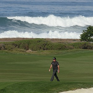 Phil Mickelson walks the 10th fairway at Monterey Peninsula Country Club during the second round of the AT&T Pebble Beach National Pro-Am golf tournament in Pebble Beach, Calif., Friday, Feb. 10, 2012.