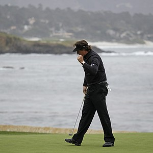 Phil Mickelson on the 18th green of the Pebble Beach Golf Links after making a birdie during the final round of the AT&T Pebble Beach National Pro-Am golf tournament in Pebble Beach, Calif., Sunday, Feb. 12, 2012. Mickelson won the tournament after shooting a 8-under-par 64 to finish at total 17-under-par.