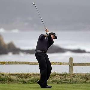Phil Mickelson hits from the 18th tee at Pebble Beach Golf Links during the final round of the AT&T Pebble Beach National Pro-Am golf tournament in Pebble Beach, Calif., Sunday, Feb. 12, 2012. Mickelson finished with an 8-under 64 to win the Pebble Beach National Pro-Am and become only the ninth player with 40 career PGA Tour wins.