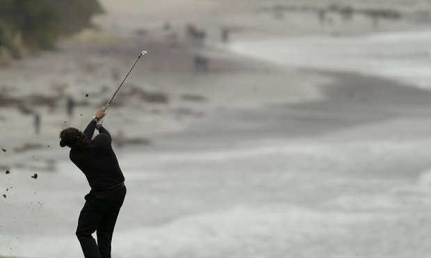Phil Mickelson hits from the ninth fairway at Pebble Beach Golf Links during the final round of the AT&T Pebble Beach National Pro-Am golf tournament in Pebble Beach, Calif., Sunday, Feb. 12, 2012.