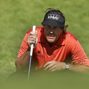 Phil Mickelson lines up a putt on the second hole during the first round of the Northern Trust Open golf tournament at Riviera Country Club in Los Angeles, Thursday, Feb. 16, 2012.