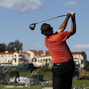 Phil Mickelson watches his tee shot on the ninth hole during the first round of the Northern Trust Open golf tournament at Riviera Country Club in Los Angeles, Thursday, Feb. 16, 2012.