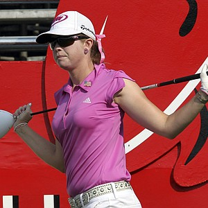 Paula Creamer of the U.S. stretches herself on the first tee during the final round of the LPGA Thailand golf championship in Pattaya, Chonburi province, southeastern Thailand Sunday, Feb. 19, 2012.