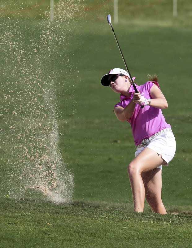 Paula Creamer of the U.S. hits a bunker shot on the first during the final round of the LPGA Thailand golf championship in Pattaya, Chonburi province, southeastern Thailand Sunday, Feb. 19, 2012.