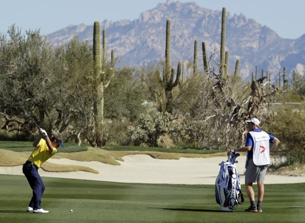 England's Luke Donald hits an approach shot on the eighth fairway while facing Ernie Els, of South Africa, during the Match Play Championship golf tournament, Wednesday, Feb. 22, 2012, in Marana, Ariz.