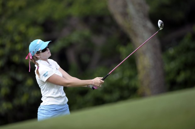 Paula Creamer of the U.S. plays on the fairway of the sixth hole during round 1 of the HSBC Women's Champions golf tournament, Thursday Feb. 23, 2012, in Singapore.