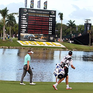 Luke Donald of England walks towards the 18th green during the second round of the Cadillac Championship golf tournament on Friday, March 9, 2012 in Doral, Fla.