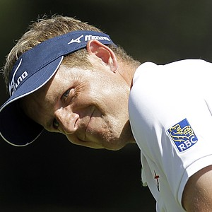 Luke Donald, of England, reacts as he putt misses the cup on the seventh hole during the second round of the Transitions golf tournament Friday, March 16, 2012, in Palm Harbor, Fla.